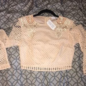 Carli Bybel X Missguided nude fish net crop top
